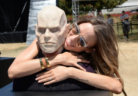 "SAN DIEGO, CA - JULY 21: Actress Ruta Gedmintas poses with A wax figure of Quinlan from ""The Strain"" at FXhibition during Comic-Con International 2016 at Hilton Bayfront on July 21, 2016 in San Diego, California. (Photo by Michael Kovac/Getty Images for FX)"